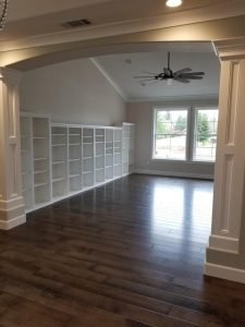 A hallway with built-in shelving.